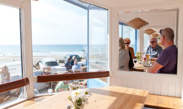 The very popular bay windows at Blue, Porthtowan Beach, Cornwall, UK