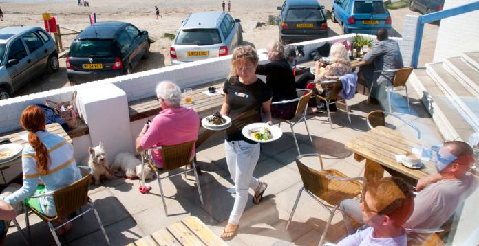 alfresco dining, the terrace at the blue bar, Porthtowan Beach, Cornwal, Uk.