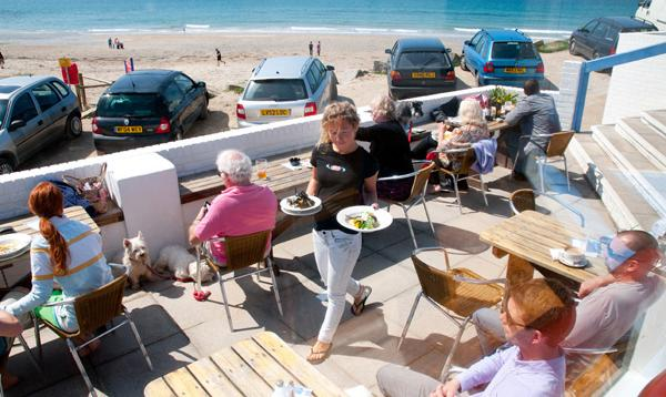 the terrace patio at the blue bar, Porthtowan beach, Cornwall,UK.