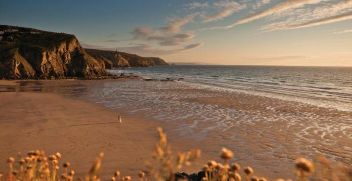 Porthtowan Beach, Cornwall, UK. evening low tide. Blue bar.