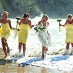 bride and bridesmaids. The Boardroom, Porthtowan Beach, Cornwall, UK.